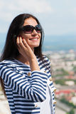 Young beautiful woman talking on cellphone Royalty Free Stock Photo