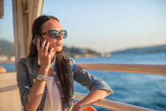 Young beautiful woman talking on her phone Royalty Free Stock Images