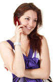 Young beautiful woman talking on mobile phone. Isolated over white Royalty Free Stock Images