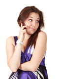 Young beautiful woman talking on mobile phone. Isolated over white Stock Images