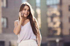 Young Beautiful Woman Talking On Mobile Phone Royalty Free Stock Photo