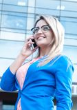 Young beautiful woman with a mobile outdoor. Stock Photos