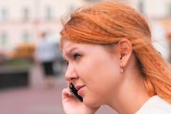 Young beautiful woman talking by phone Royalty Free Stock Photos