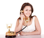 Young beautiful woman talking by phone. Stock Image