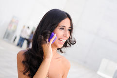 Young beautiful woman talking on phone. Young beautiful woman phoning in the street Royalty Free Stock Photos