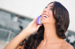 Young beautiful woman talking on phone. Young beautiful woman phoning in the street Royalty Free Stock Photography