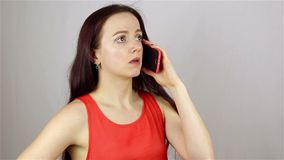 Young beautiful woman talking on the phone. Bad news. stock footage