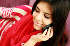 Young beautiful woman talking on the phone Royalty Free Stock Photos