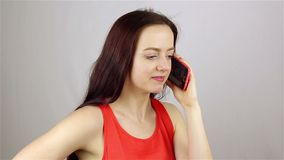Young beautiful woman talking on the phone stock footage