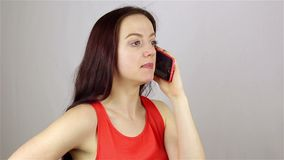 Young beautiful woman talking on the phone stock video footage