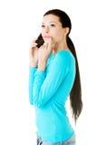 Young beautiful woman talking through phone. Royalty Free Stock Photo