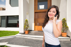Young beautiful woman talking on the phone outside Stock Images