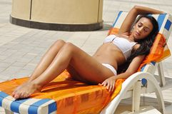 Young beautiful woman tanning Stock Images