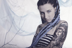 Young beautiful woman with tattoo and dreadlocks Royalty Free Stock Photography