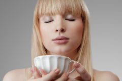 Young beautiful woman with tea Royalty Free Stock Photos