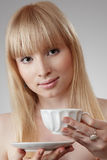 Young beautiful woman with tea Royalty Free Stock Photography