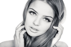 Young beautiful woman. Tender and sensual young beautiful woman, slightly toned black and white portrait Stock Images