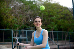 Young beautiful woman tennis player practice in tennis court Stock Image