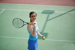 Young beautiful woman tennis player practice in tennis court Royalty Free Stock Image