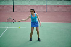 Young beautiful woman tennis player practice in tennis court Stock Photography
