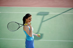 Young beautiful woman tennis player practice in tennis court Stock Photos