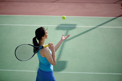 Young beautiful woman tennis player practice in tennis court Royalty Free Stock Photography