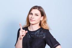 Young beautiful woman threaten finger Stock Photo