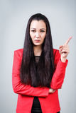 Young beautiful woman threaten finger. On the gray background stock image