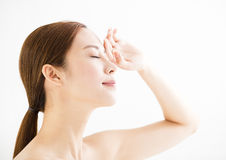 Young beautiful woman with tired eyes. Young beautiful asian woman with tired eyes stock photo