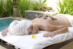 The young beautiful woman to Spa procedures Royalty Free Stock Photo