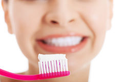 Young beautiful woman with toothbrush and paste. Royalty Free Stock Photos