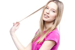 Young beautiful woman touches her hair Royalty Free Stock Photo