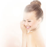 Young beautiful woman touching her face Royalty Free Stock Photo