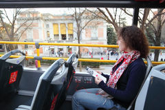 Young beautiful woman in tourist bus near Prado royalty free stock image