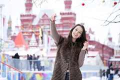 Young beautiful woman tourist taking pictures on mobile phone Royalty Free Stock Image