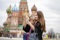 Young beautiful woman tourist taking pictures on mobile phone Stock Image