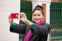 Young beautiful woman tourist taking pictures on mobile phone Stock Photo