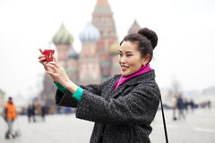 Young beautiful woman tourist taking pictures on mobile phone Royalty Free Stock Photography