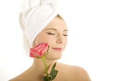 Young beautiful woman in towel with pink flower Royalty Free Stock Photography