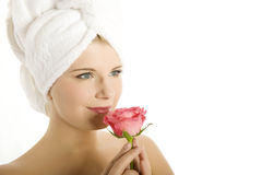 Young beautiful woman in towel with pink flower Stock Photography
