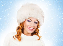 Young and beautiful woman in a traditional winter hat Stock Image