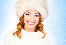 Young and beautiful woman in a traditional winter hat Royalty Free Stock Photography