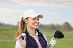 Young beautiful woman is training golf in autumn stock photos