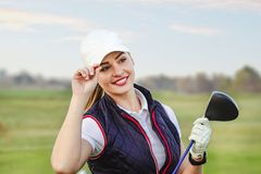 Young beautiful woman is training golf in autumn stock images