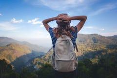 Young beautiful woman traveler enjoys mountain, beautiful landscape and active lifestyle. Sri Lanka - Ceylon Island royalty free stock image