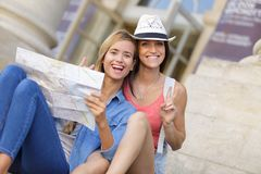 Young beautiful woman travelers exploring city Royalty Free Stock Image