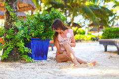 Young beautiful woman during tropcal exotic beach. Young woman during tropcal exotic beach vacation Stock Photo