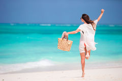 Young beautiful woman on tropical beach at caribbean vacation have fun Stock Photo
