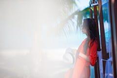 Young beautiful woman during tropical beach Stock Photos