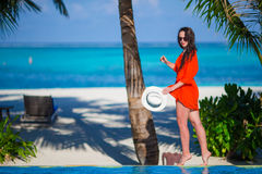 Young beautiful woman on tropical beach vacation Royalty Free Stock Photos